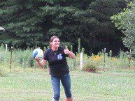 a woman playing volleyball at an independence day celebration at Recovery Ventures