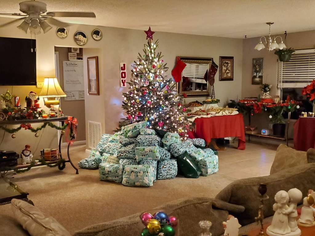a christmas tree with presents and decorations for a sober holiday celebration at Recovery Ventures